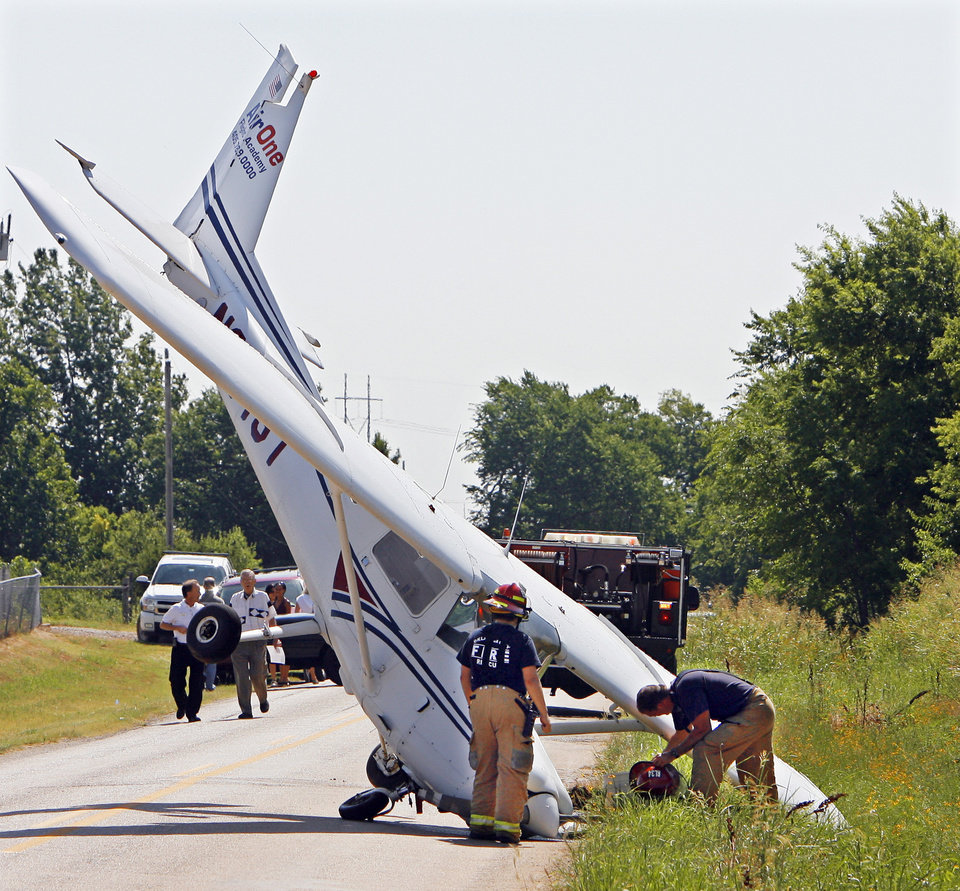An Air One Flight Academy plane stand on its nose on NW 122nd near Sara Road after it skidded off the end of a runway at Sun Dance Airport, Wednesday,  June 24, 2009. Photo By David McDaniel, The Oklahoman.