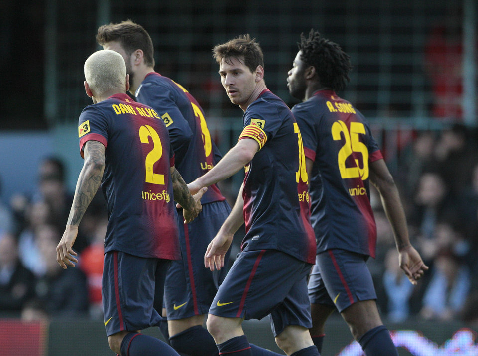 FC Barcelona's Lionel Messi from Argentina, center, celebrates with teammates after scoring the first goal against RC Celta during a Spanish La Liga soccer match at the Balaidos stadium in Vigo, Spain, Saturday, March 30, 2013. (AP Photo/Lalo R. Villar)