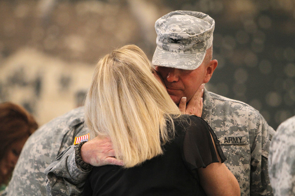 Photo - Col. Van L. Kinchen greets his wife, Crystal, during the change of command ceremony in Norman on Sunday.  Photos by Garett Fisbeck, The Oklahoman