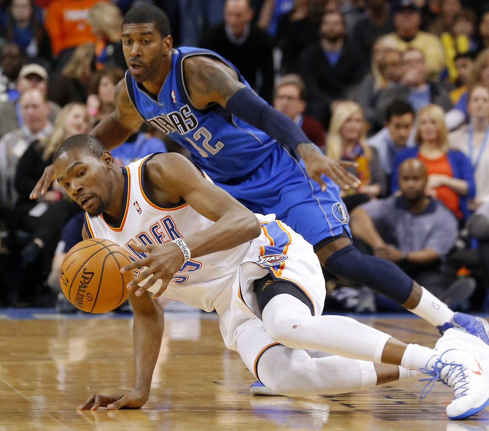 Photo - Oklahoma City's Kevin Durant (35) gains control of the ball in front of Dallas' O.J. Mayo (32) during an NBA basketball game between the Oklahoma City Thunder and the Dallas Mavericks at Chesapeake Energy Arena in Oklahoma City, Thursday, Dec. 27, 2012.  Oklahoma City won 111-105. Photo by Bryan Terry, The Oklahoman