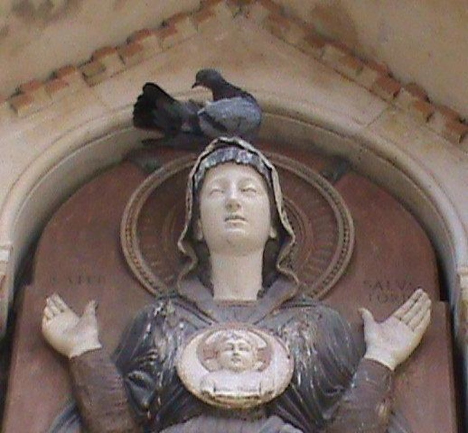 Photo - Many religious statues can be seen in Venice and show the influence of the Catholic Church in the city and Italy. This colorful Madonna statue is not only colorful but serves as a resting place for a pigeon. PHOTO BY JOE HIGHT, THE OKLAHOMAN.