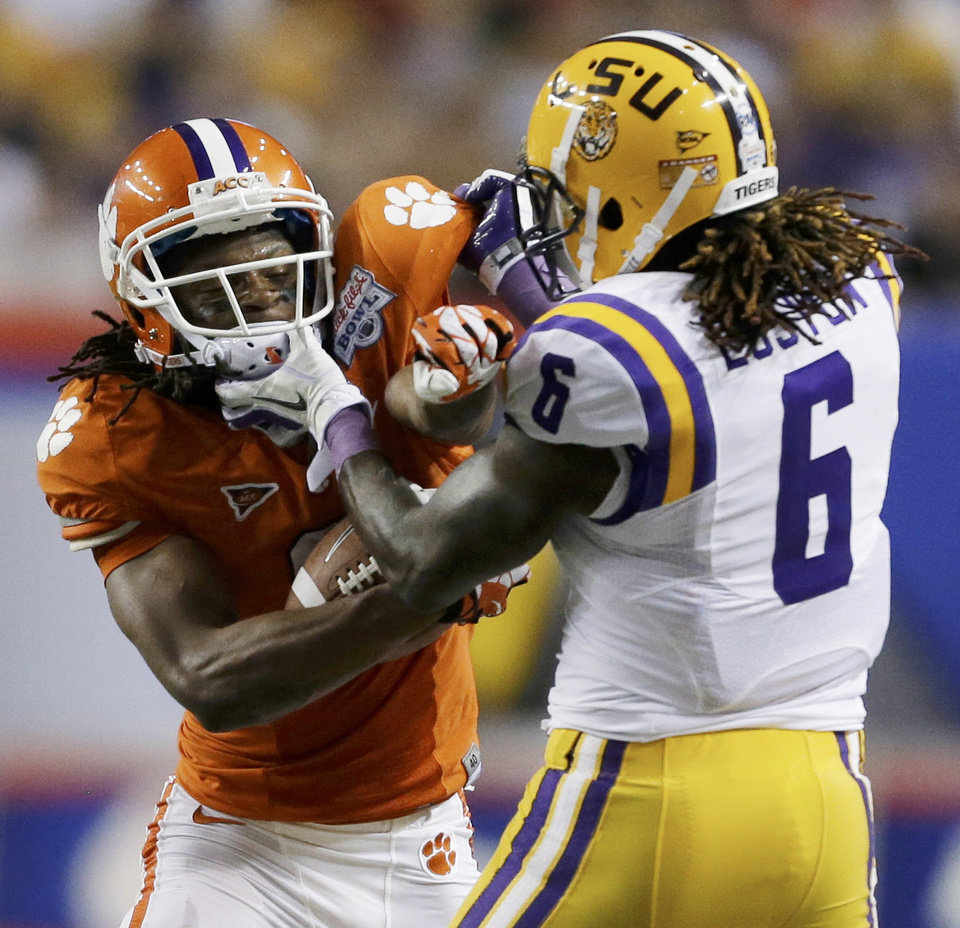 Photo - Clemson wide receiver DeAndre Hopkins (6) clashes with LSU safety Craig Loston (6) during the first half of the Chick-fil-A Bowl NCAA college football game, Monday, Dec. 31, 2012, in Atlanta. (AP Photo/David Goldman)