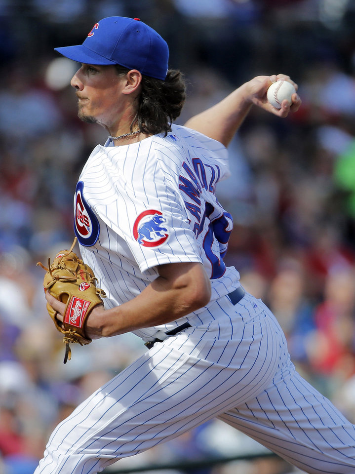 Photo - Chicago Cubs pitcher Jeff Samardzija throws during the first inning of a spring training baseball game against the Arizona Diamondbacks, Thursday, Feb. 27, 2014, in Mesa, Ariz. (AP Photo/Matt York)