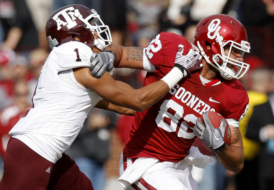 Oklahoma's Roy Finch (22) fights off Texas A&M's Trent Hunter (1) during the college football game between the Texas A&M Aggies and the University of Oklahoma Sooners (OU) at Gaylord Family-Oklahoma Memorial Stadium on Saturday, Nov. 5, 2011, in Norman, Okla. Oklahoma won 41-25.  Photo by Bryan Terry, The Oklahoman