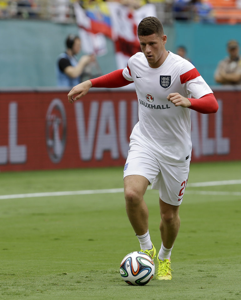 Photo - England's Ross Barkley (21) warms up before a friendly soccer match against Ecuador in Miami Gardens, Fla., Wednesday, June 4, 2014. (AP Photo/Alan Diaz)