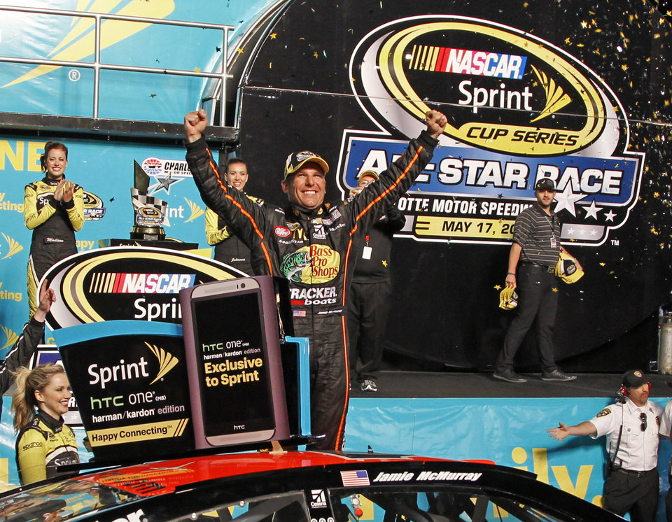 Photo - Jamie McMurray celebrates in Victory Lane after winning the NASCAR Sprint All-Star auto race at Charlotte Motor Speedway in Concord, N.C., Saturday, May 17, 2014. (AP Photo/Terry Renna)