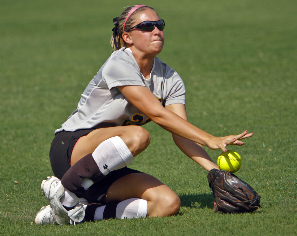 Photo - Roff's Kelsey Anderson tries to make a catch during the Class 2A state championship softball tournament at ASA Hall of Fame Stadium on Wednesday, May 2, 2012, in Oklahoma City, Oklahoma. Photo by Chris Landsberger, The Oklahoman