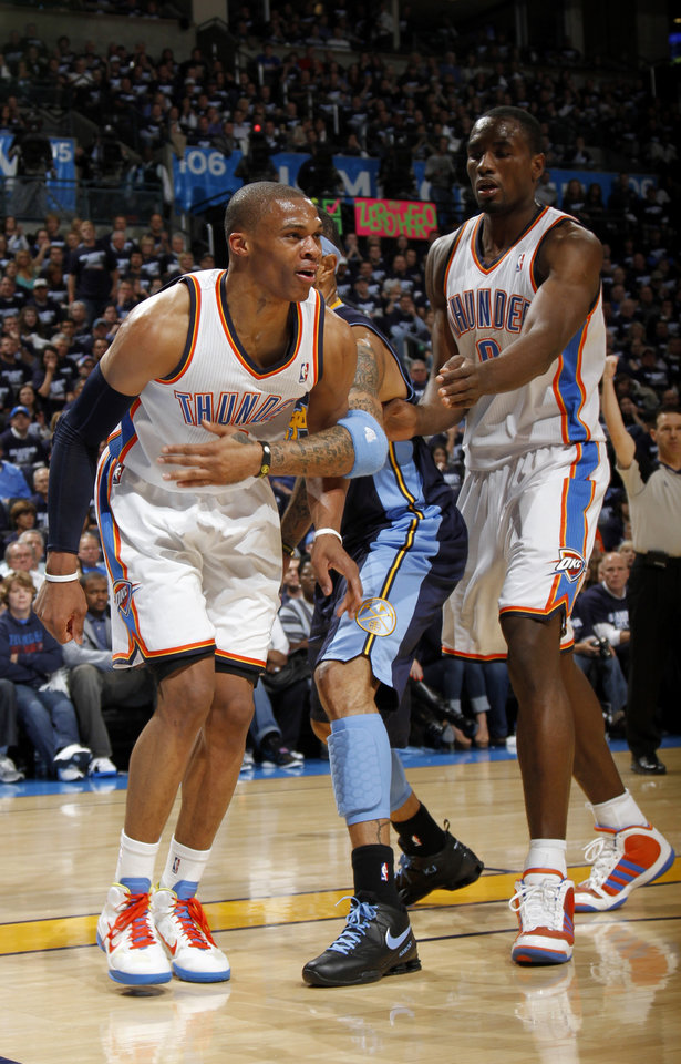 Photo - Denver's Kenyon Martin (4), Oklahoma City's Serge Ibaka (9) hold Russell Westbrook (0) back after a being fouled by  Denver's Nene (31) during the NBA basketball game between the Denver Nuggets and the Oklahoma City Thunder in the first round of the NBA playoffs at the Oklahoma City Arena, Wednesday, April 27, 2011. Photo by Bryan Terry, The Oklahoman