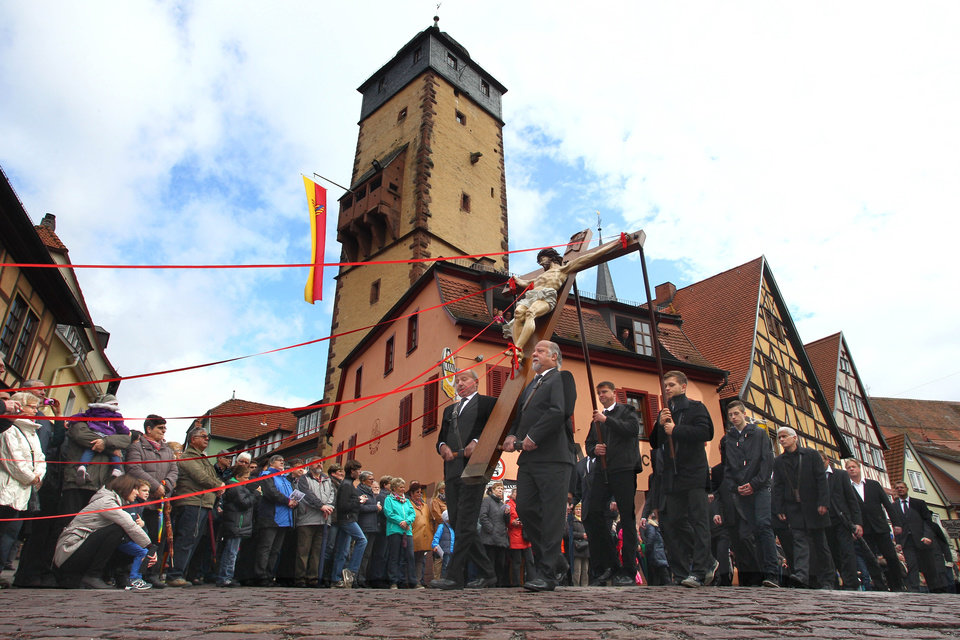 Photo - Thirteen life-sized figures representing the Passion of Christ are carried through the town during the traditional Good Friday procession in Lohr am Main,southern Germany, Friday, April 18, 2014. (AP Photo/dpa, Karl-Josef Hildenbrand)