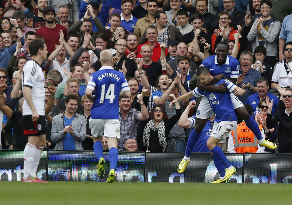Photo - Everton's Kevin Miralles, right bottom, celebrates his goal against Fulham with teammates during their English Premier League soccer match at Craven Cottage, London, Sunday, March 30, 2014. (AP Photo/Sang Tan)