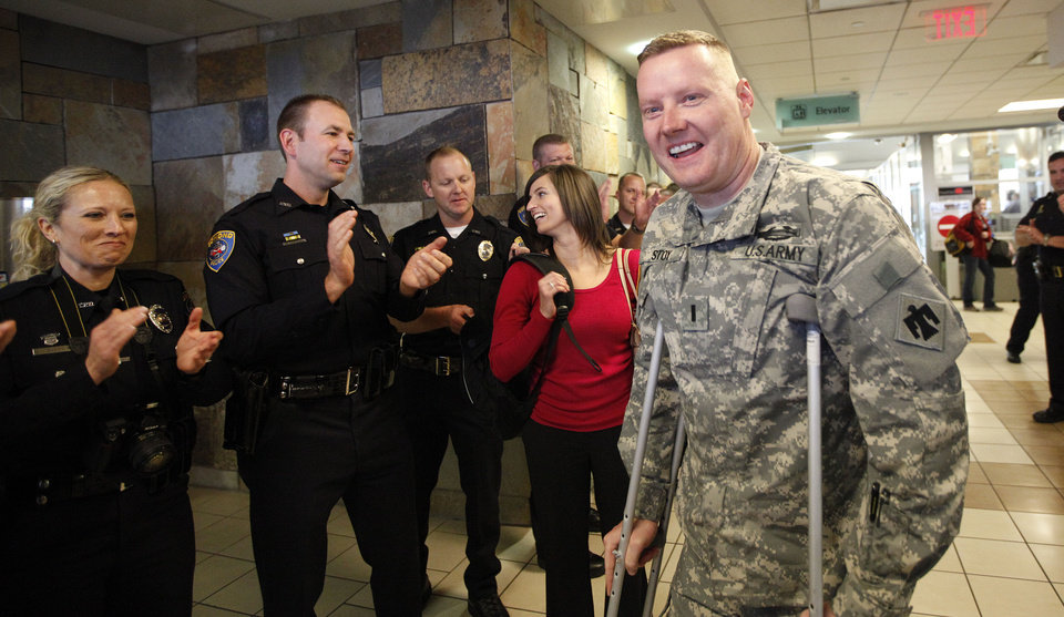 Edmond Police officer Kyle Stoy and Oklahoma National Guard soldier returns home at Will Rogers World Airport in  Oklahoma City, Thursday, March 22, 2012. Photo by Sarah Phipps, The Oklahoman.
