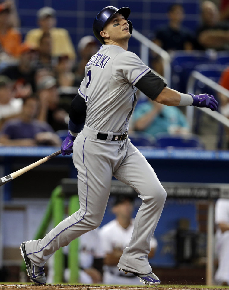 Photo - Colorado Rockies shortstop Troy Tulowitzki watches after hitting a single in the first inning of a baseball game against the Miami Marlins, Thursday, April 3, 2014, in Miami. (AP Photo/Lynne Sladky)