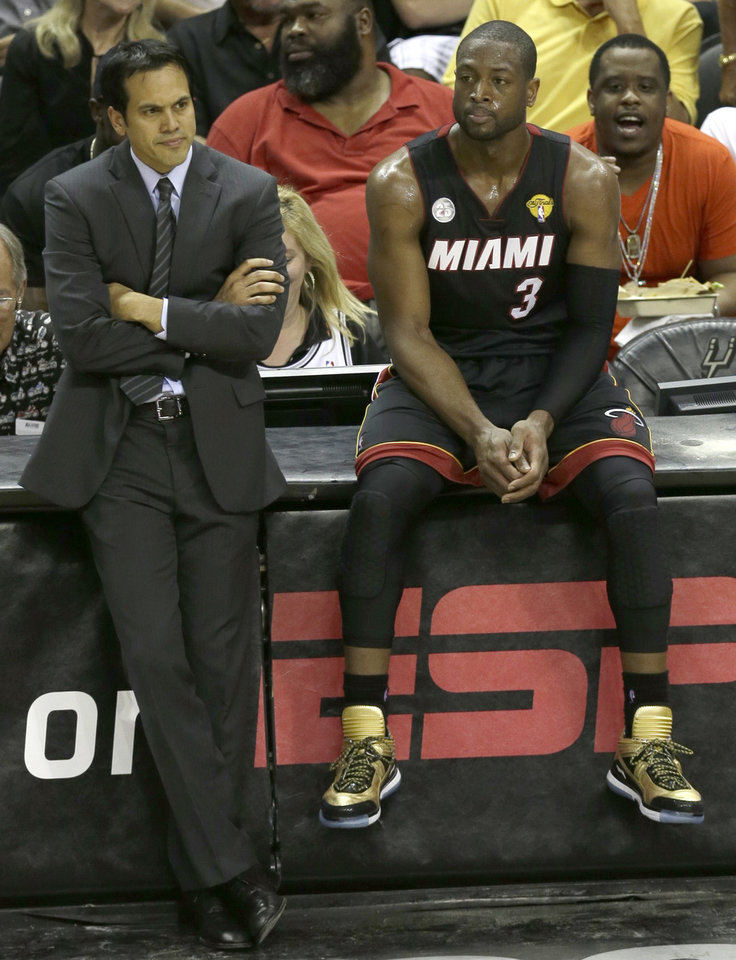 Miami Heat's Erik Spoelstra and Dwyane Wade (3) watch against the San Antonio Spurs during the second half of Game 4 of the NBA Finals basketball series, Thursday, June 13, 2013, in San Antonio. (AP Photo/David J. Phillip)
