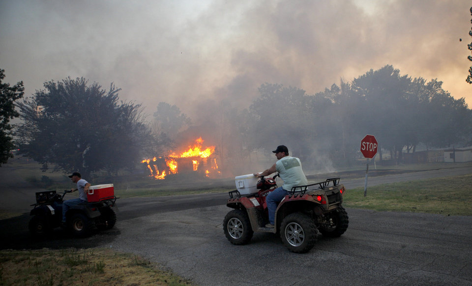 Photo - Residents bring water to firefighters in Luther, Okla., after wildfire moved through the area on Friday, August 3, 2012. Photo by Bryan Terry, The Oklahoman