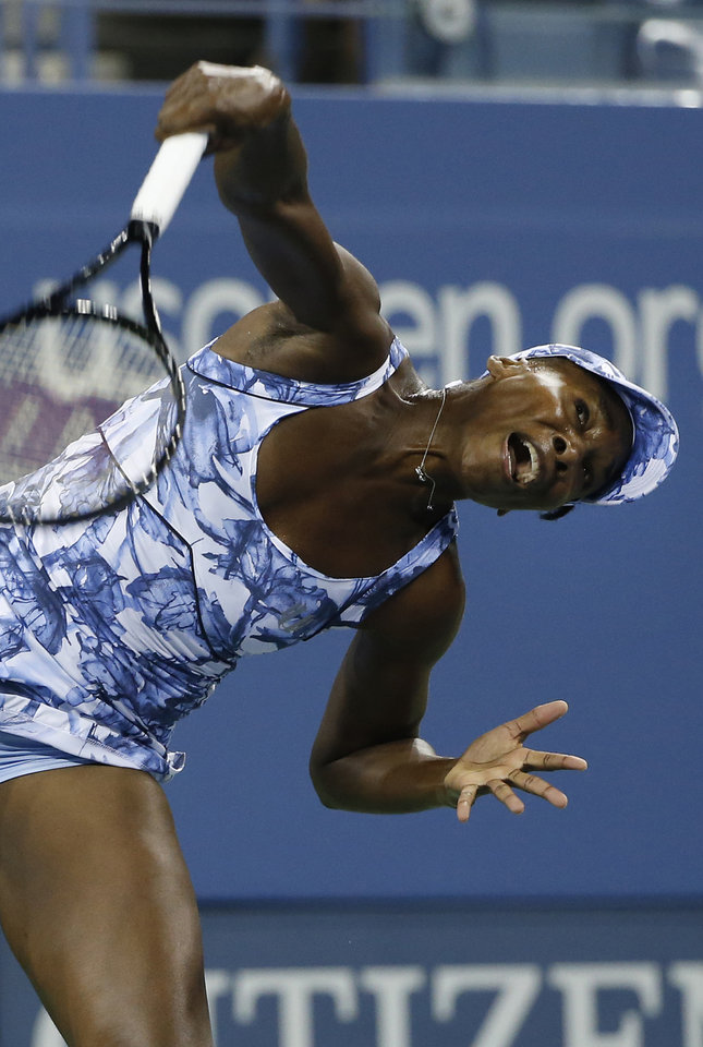 Photo - Venus Williams, of the United States, serves to Timea Bacsinszky, of Switzerland, during the second round of the U.S. Open tennis tournament Wednesday, Aug. 27, 2014, in New York. (AP Photo/Jason DeCrow)