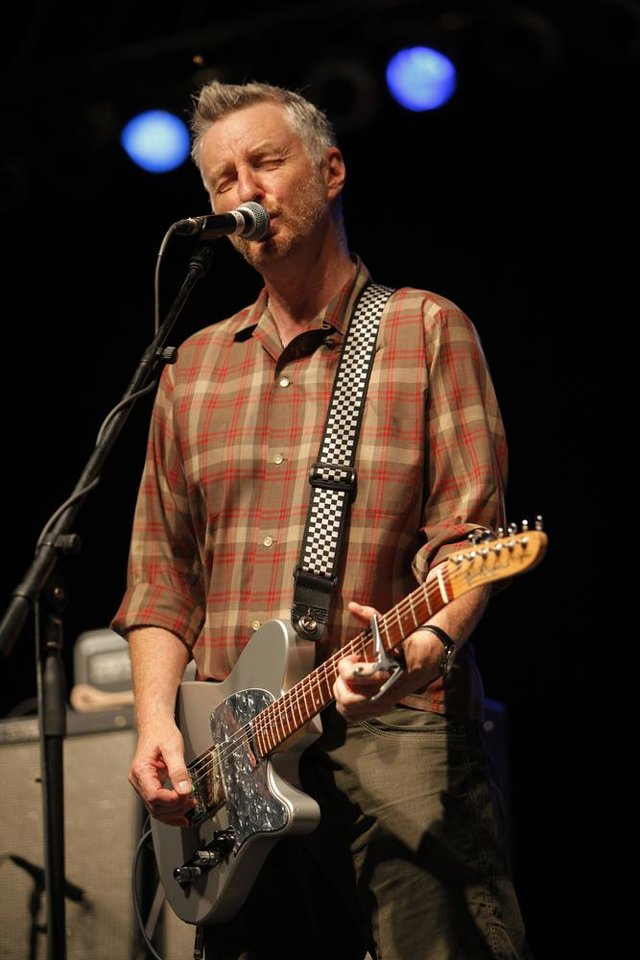 Photo -  Billy Bragg performs during the Woody Guthrie Folk Festival in Okemah, Okla., Thursday, July 12, 2012.  Photo by Garett Fisbeck, The Oklahoman