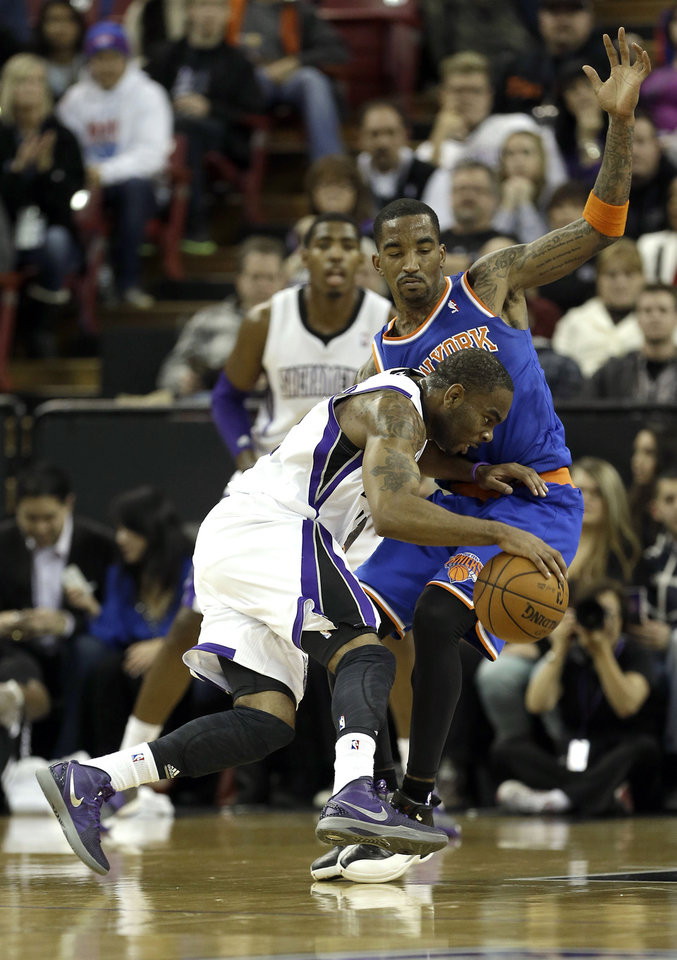 Sacramento Kings guard Marcus Thornton, left, tries to drive against New York Knicks guard J.R. Smith during the first quarter of an NBA basketball game in Sacramento, Calif., Friday, Dec. 28, 2012.(AP Photo/Rich Pedroncelli)