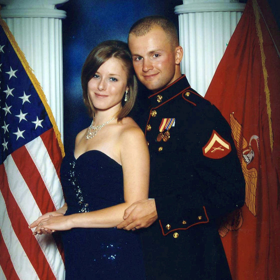 Photo - FILE - This undated file photo provided by the San Bernardino County, Calif., Sheriff's Department shows Erin Corwin, left, with her husband, Jonathan Wayne Corwin, a corporal in the U.S. Marine Corps. Erin Corwin disappeared after leaving her home on the Twentynine Palms Marine Corps base June 28, 2014. Christopher Brandon Lee, a recently discharged Marine who volunteered at a horse ranch with Erin Corwin, was arrested July 4, 2014, on suspicion of possession of a destructive device. Lee, the alleged lover of Erin Corwin, was arrested Sunday, Aug. 18, 2014, in Alaska in connection with Corwin's disappearance, the sheriff's department announced Monday, Aug. 8, 2014. (AP Photo/San Bernardino County Sheriff's Department, File)