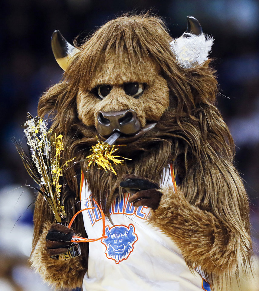 Photo - Thunder mascot Rumble the Bison carries some New Year's Eve party favors during an NBA basketball game between the Oklahoma City Thunder and Dallas Mavericks at Chesapeake Energy Arena in Oklahoma City, Monday, Dec. 31, 2018. Photo by Nate Billings, The Oklahoman
