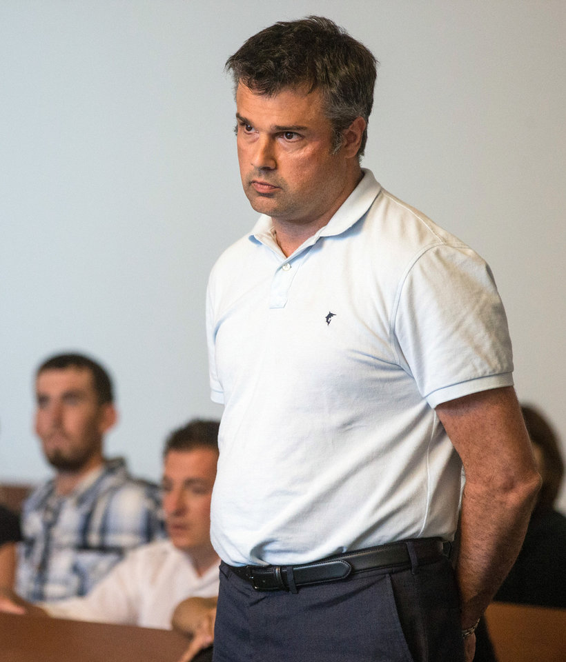 Photo - Jet Blue pilot John Manwaring stands as he is arraigned in Boston Municipal Court on a heroin possession charge Monday, July 21, 2014, in Boston. Manwaring, who listed his home as Maitland, Fla., was among six people arrested Sunday during an investigation into drug dealing near the Boston Common, Boston police said.  (AP Photo/The Boston Globe, Aram Boghosian, Pool)