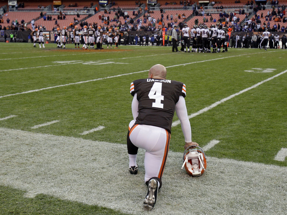 Cleveland Browns placekicker Phil Dawson watches the final seconds of a 25-15 loss to the Baltimore Ravens in an NFL football game on Sunday, Nov. 4, 2012, in Cleveland. Dawson kicked five field goals to account for all of the Browns' points. (AP Photo/Tony Dejak)