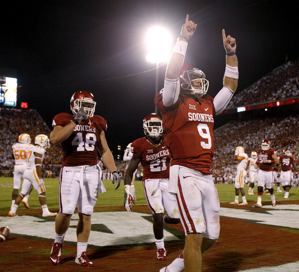 Photo - Oklahoma's Trevor Knight (9) celebrates after scoring a touchdown during a college football game between the University of Oklahoma Sooners (OU) and the Tennessee Volunteers at Gaylord Family-Oklahoma Memorial Stadium in Norman, Okla., on Saturday, Sept. 13, 2014. Photo by Bryan Terry, The Oklahoman