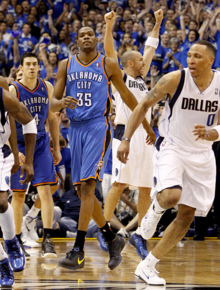Photo - Oklahoma City's Kevin Durant (35) and Nick Collison (4) walk off the court as Jason Kidd (2) and Shawn Marion (0) Dallas celebrate after Oklahoma City's loss in game 5 of the Western Conference Finals in the NBA basketball playoffs between the Dallas Mavericks and the Oklahoma City Thunder at American Airlines Center in Dallas, Wednesday, May 25, 2011. Photo by Bryan Terry, The Oklahoman