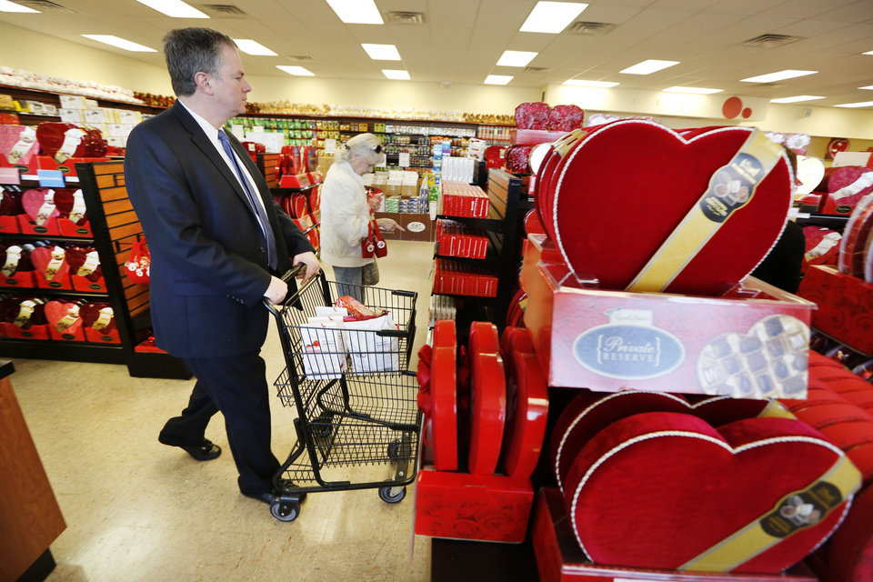 More than half of Valentine�s Day gift-givers were expected to purchase candy this year, according to the National Retail Federation. Above, Mike Andre shops for gifts Wednesday at Russell Stover Candies in Oklahoma City. See more in Business on Page 2B. PHOTO BY STEVE GOOCH, THE OKLAHOMAN