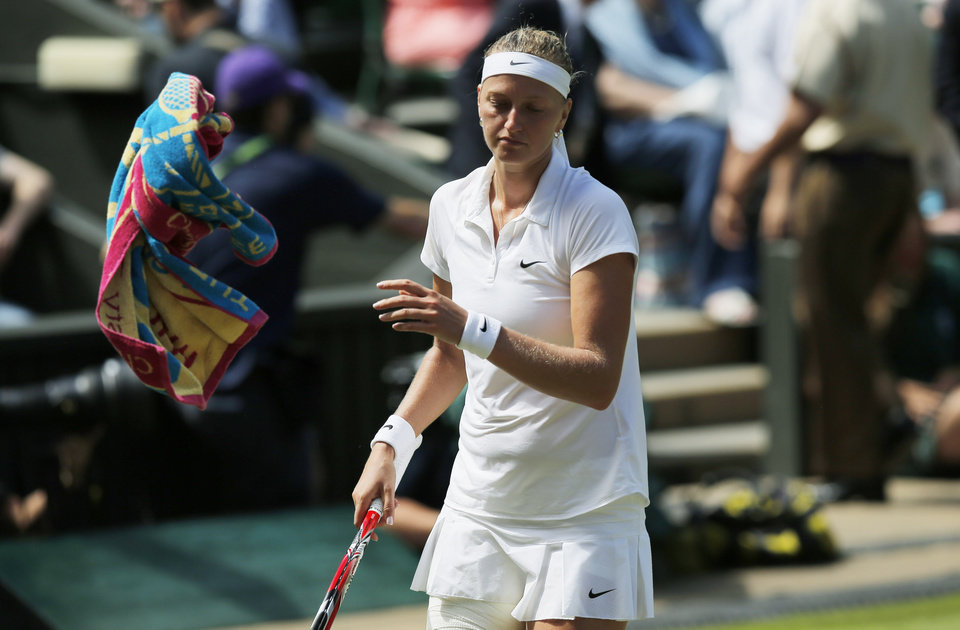 Photo - Petra Kvitova of Czech Republic throws a towel to a ball boy during her women's singles semifinal match against Lucie Safarova of Czech Republic at the All England Lawn Tennis Championships in Wimbledon, London, Thursday, July 3, 2014. (AP Photo/Pavel Golovkin)