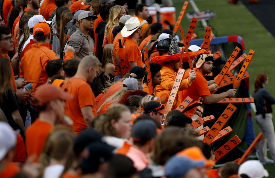 Photo - Oklahoma State fans cheer before a college football game between Oklahoma State (OSU) and South Alabama at Boone Pickens Stadium in Stillwater, Okla., Saturday, Sept. 8, 2018. Photo by Sarah Phipps, The Oklahoman