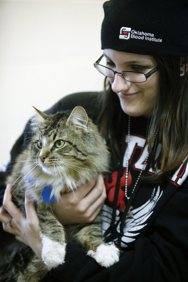 Left: Megan Brannan holds a cat at the event.