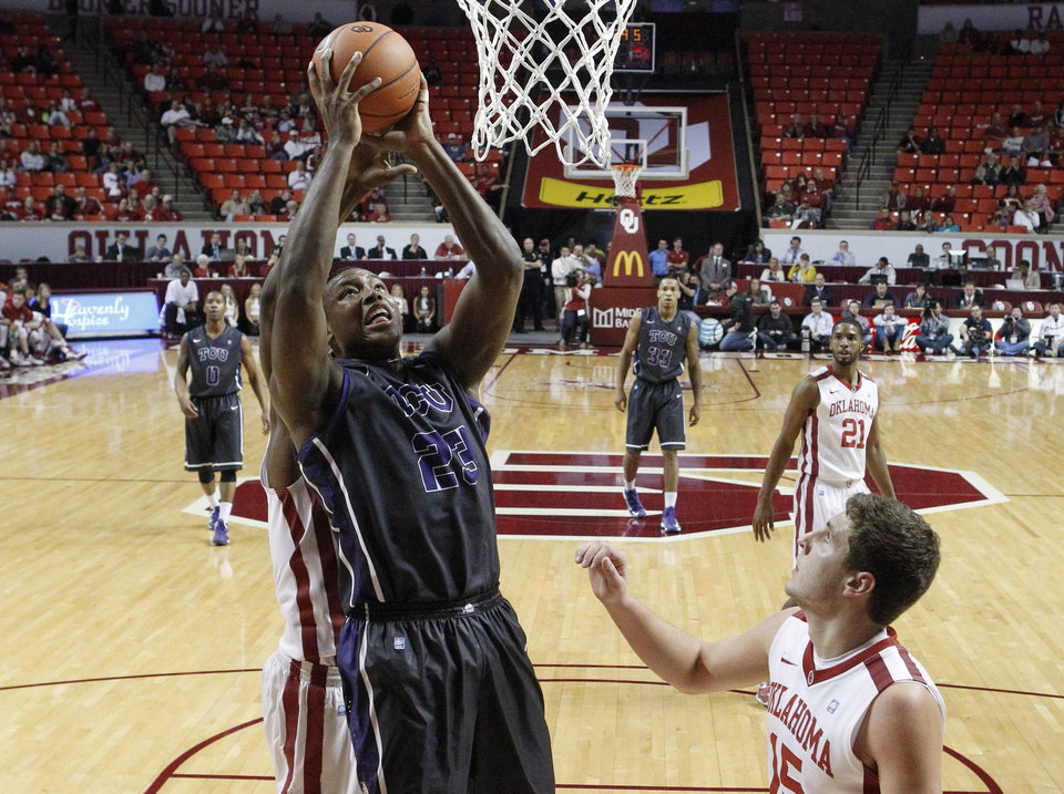 TCU forward Devonta Abron (23) shoots in front of Oklahoma forward Tyler Neal (15) in the second half of an NCAA college basketball game in Norman, Okla., Monday, Feb. 11, 2013. Oklahoma won 75-48.(AP Photo/Sue Ogrocki)