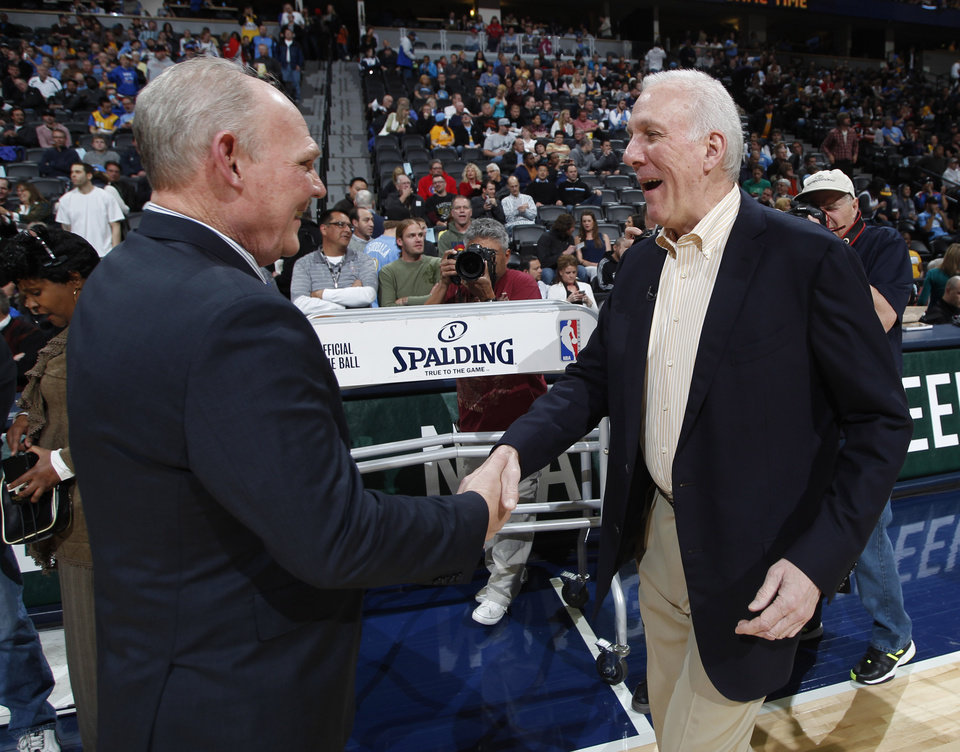 San Antonio Spurs head coach Gregg Popovich, right, greets Denver Nuggets head coach Geoge Karl before an NBA basketball game in Denver, Wednesday, April 10, 2013. (AP Photo/David Zalubowski)
