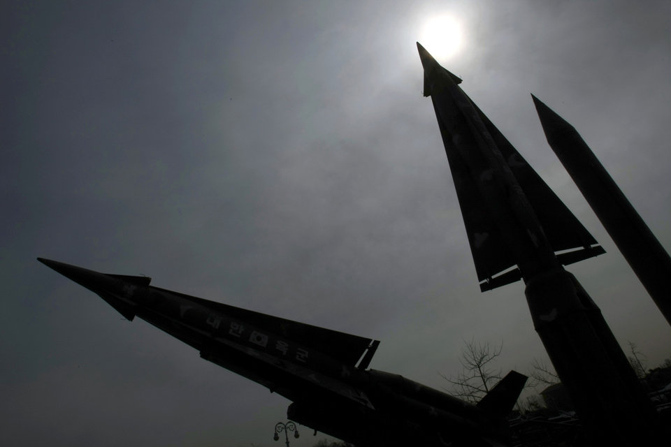 Photo -   A mock North Korean Scud-B missile, right, and other South Korean missiles are silhouetted at the Korea War Memorial Museum in Seoul, Monday, March 19, 2012. North Korea vowed Sunday to go ahead with plans to launch a long-range rocket, rejecting criticism in the West that it would scuttle recent diplomacy. (AP Photo/Lee Jin-man)