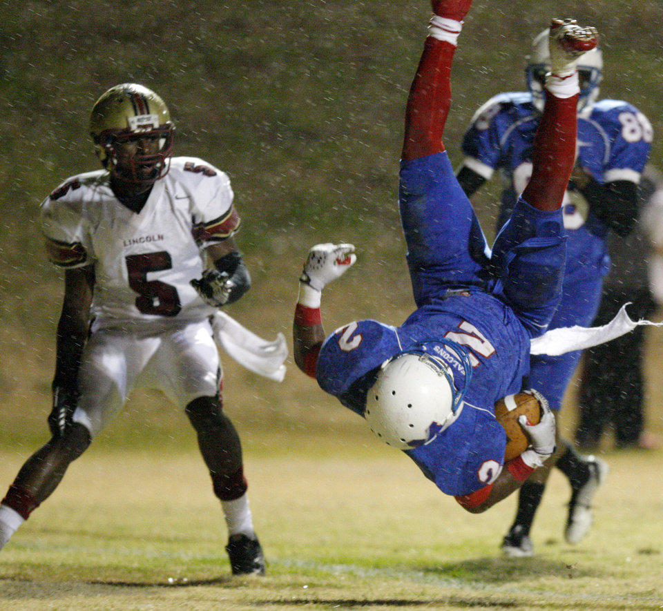 Photo - Millwood's Marc Robinson flies through the air for a touchdown beside Lincoln Christian's Anthony Wilkinson during a Class 2A high school football playoff game between Millwood and Lincoln Christian in Oklahoma City, Friday, Nov. 25, 2011. Photo by Bryan Terry, The Oklahoman
