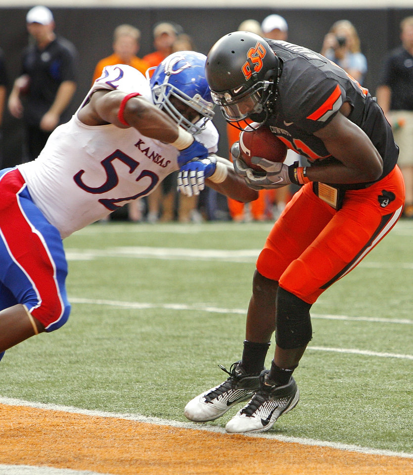 Photo - Oklahoma State's Justin Blackmon (81) reaches the goal line with his toes, but the play is rulled not a touchdown during a college football game between the Oklahoma State University Cowboys (OSU) and the University of Kansas Jayhawks (KU) at Boone Pickens Stadium in Stillwater, Okla., Saturday, Oct. 8, 2011.  Defending is Kansas' Steven Johnson (52). Photo by Steve Sisney, The Oklahoman