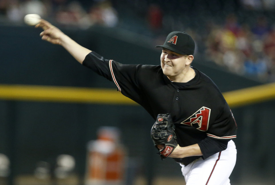 Photo - Arizona Diamondbacks' Trevor Cahill delivers a pitch in the first inning of a baseball game against the Colorado Rockies, Saturday, Aug. 9, 2014, in Phoenix. (AP Photo/Darryl Webb)