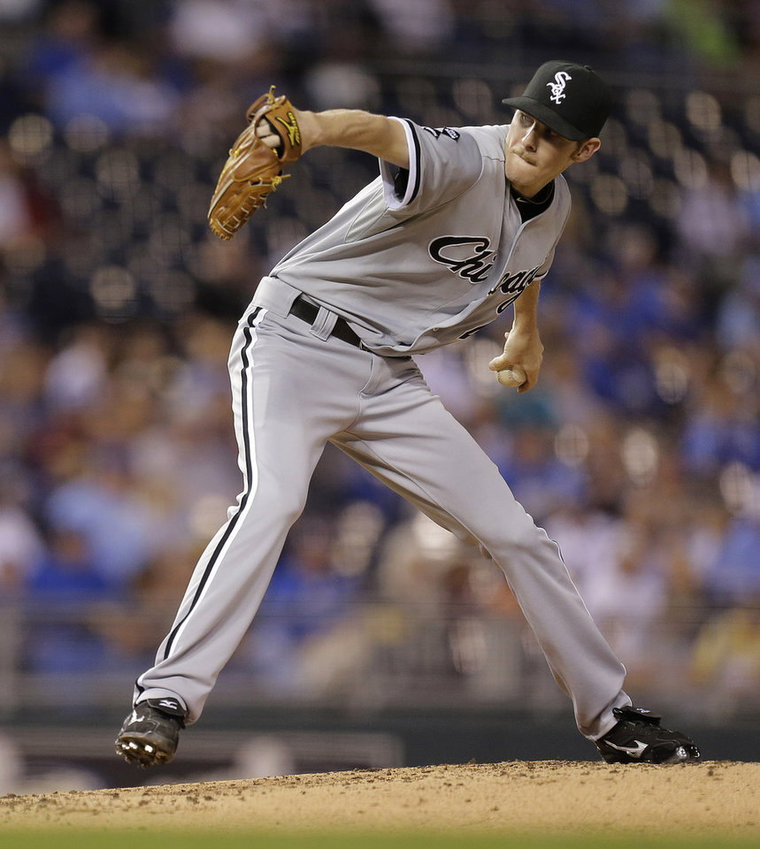 Photo -   Chicago White Sox starting pitcher Chris Sale throws during the second inning of a baseball game against the Kansas City Royals Wednesday, Sept. 19, 2012, in Kansas City, Mo. (AP Photo/Charlie Riedel)