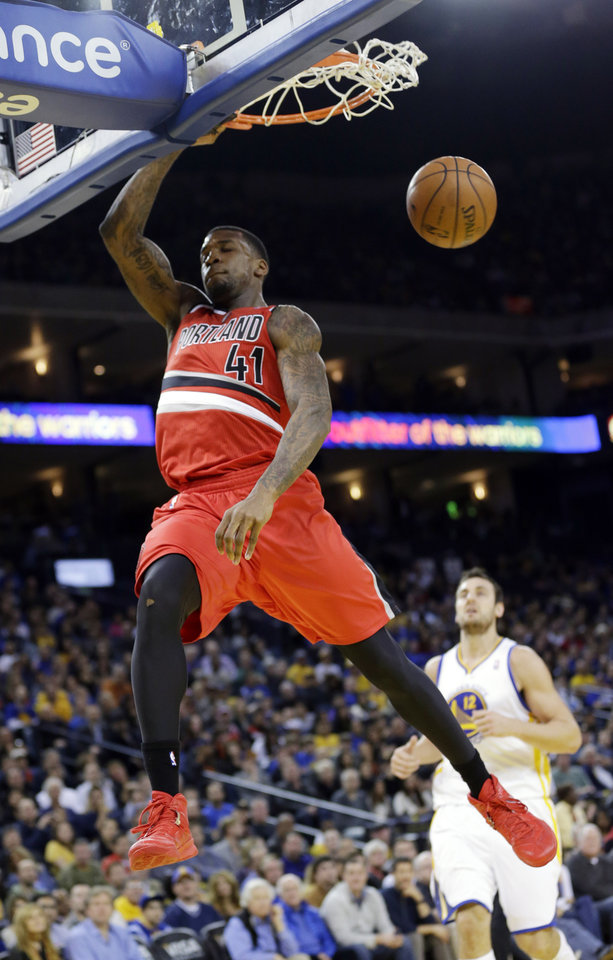 Photo - Portland Trail Blazers' Thomas Robinson (41) dunks against the Golden State Warriors during the first half of an NBA basketball game on Sunday, Jan. 26, 2014, in Oakland, Calif. (AP Photo/Marcio Jose Sanchez)