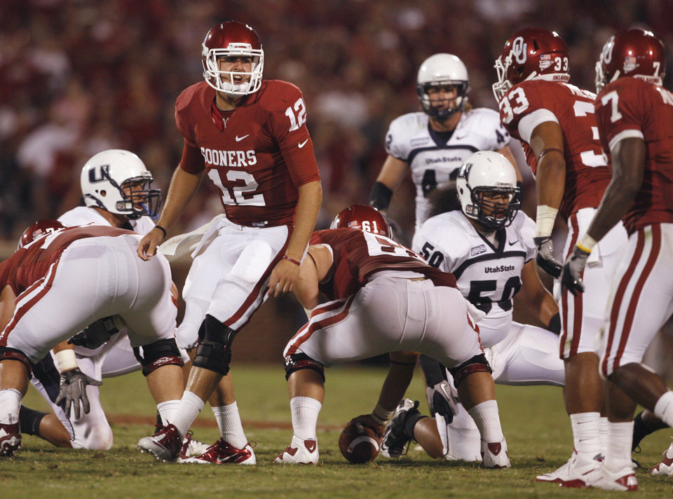 Photo - Landry Jones (12) calls out a play at the line of scrimmage during the second half of the college football game between the University of Oklahoma Sooners (OU) and Utah State University Aggies (USU) at the Gaylord Family-Oklahoma Memorial Stadium on Saturday, Sept. 4, 2010, in Norman, Okla.   Photo by Steve Sisney, The Oklahoman