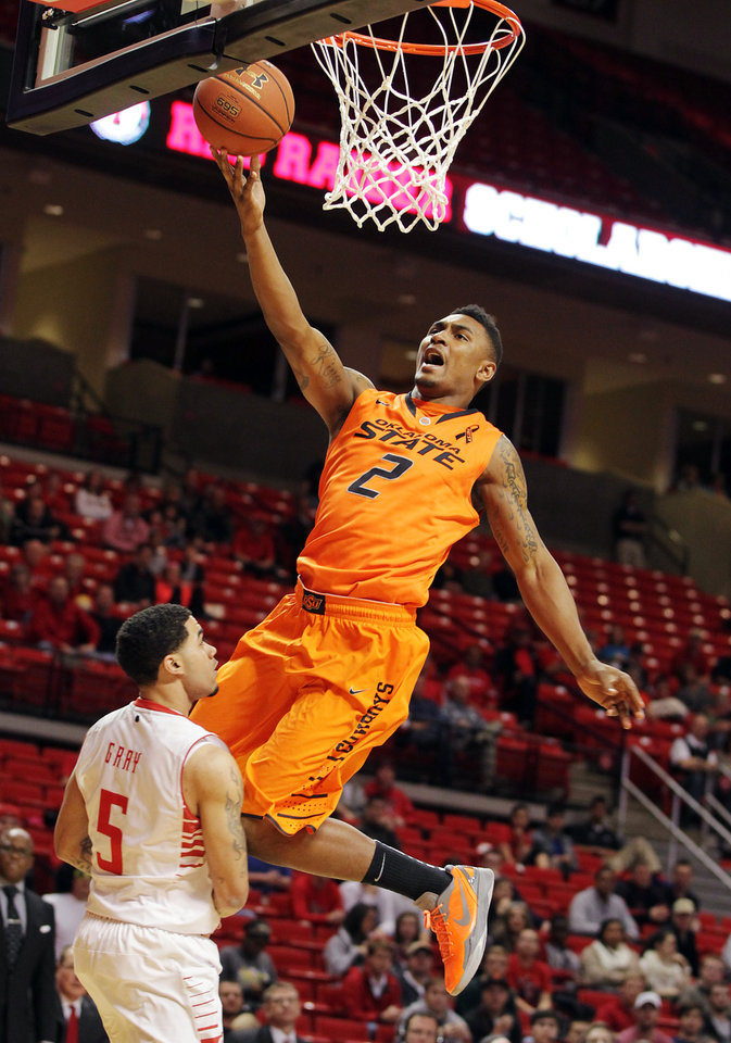 Oklahoma State's Le'Bryan Nash (2) shoots in front of Texas Tech's Josh Gray during their NCAA college basketball game, Wednesday, Feb. 13, 2013, in Lubbock, Texas. (AP Photo/The Avalanche-Journal, Zach Long) ALL LOCAL TV OUT ORG XMIT: TXLUB102