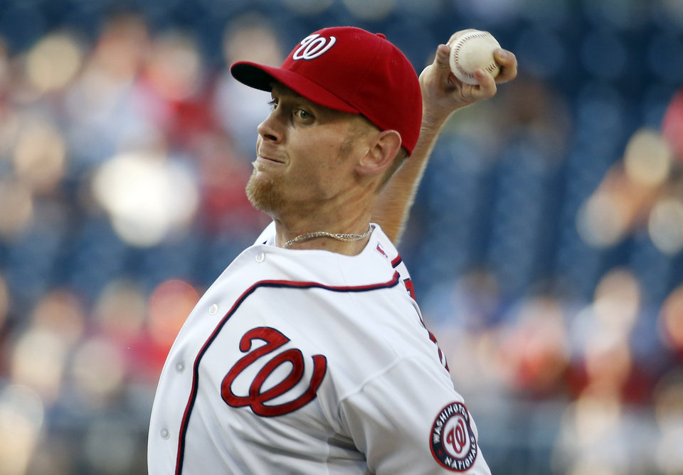 Photo - Washington Nationals starting pitcher Stephen Strasburg throws during the first inning of a baseball game against the Atlanta Braves at Nationals Park on Friday, June 20, 2014, in Washington. (AP Photo/Alex Brandon)