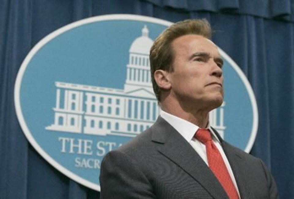 Photo - Gov.  Arnold  Schwarzenegger is seen at a news conference where he signed four executive orders requiring the posting of audits of state agencies and programs online, at the Capitol in Sacramento, Calif. on Thursday, June 4, 2009.  Schwarzenegger says with California facing a financial crisis, it's more important than ever for state government to operate efficiently and transparently. (AP Photo/Rich Pedroncelli)