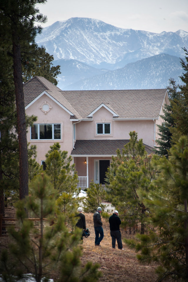 Photo - Members of the news media stand Wednesday, March 20, 2013 outside the front of the Monument, Colo. home of Colorado Department of Corrections Executive Director Tom Clements. Clements was shot dead at his home Tuesday night. (AP PHOTO/THE GAZETTE/MARK REIS)