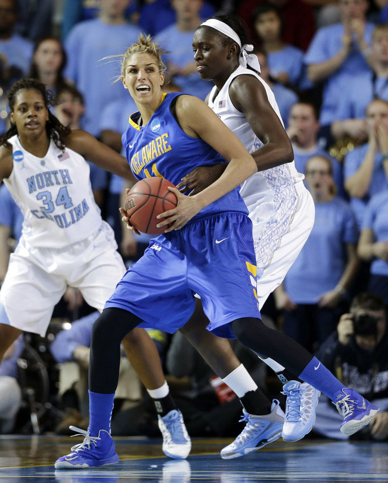 Photo - Delaware's Elena Delle Donne, front, drives around North Carolina forward Xylina McDaniel (34) and center Waltiea Rolle during the first half of a second-round game in the women's NCAA college basketball tournament in Newark, Del., Tuesday, March 26, 2013. (AP Photo/Patrick Semansky)  Patrick Semansky