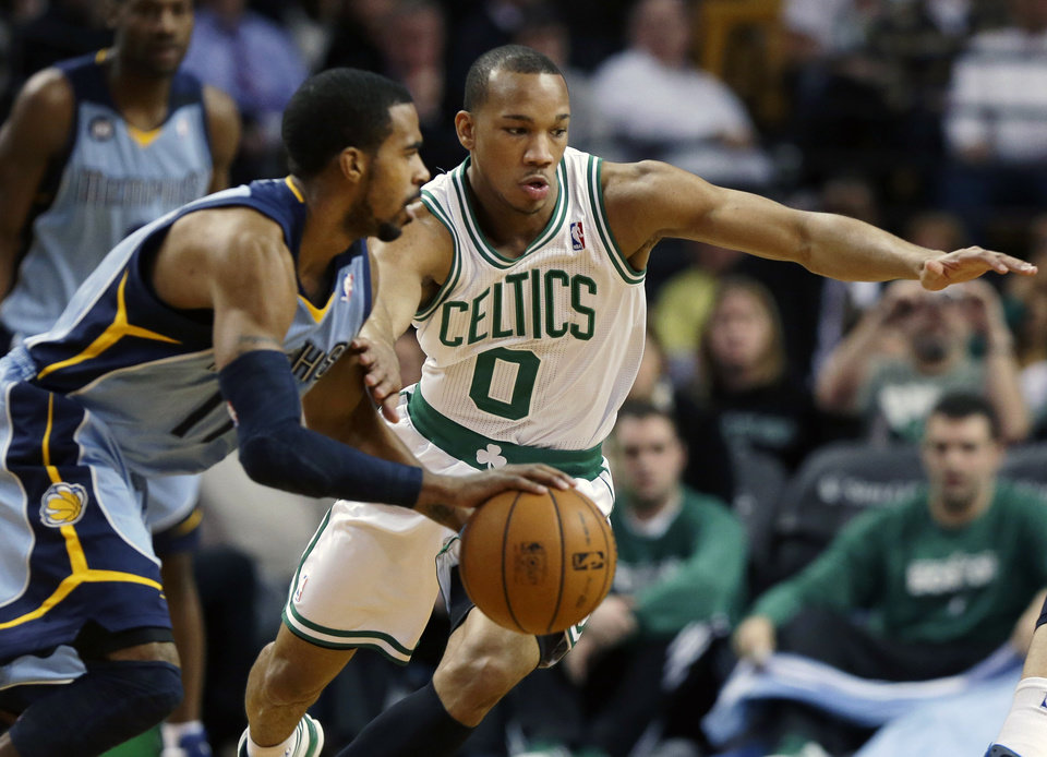 Photo - Boston Celtics point guard Avery Bradley (0) defends against Memphis Grizzlies point guard Mike Conley (11) during the first quarter of an NBA basketball game in Boston, Wednesday, Jan. 2, 2013. (AP Photo/Elise Amendola)