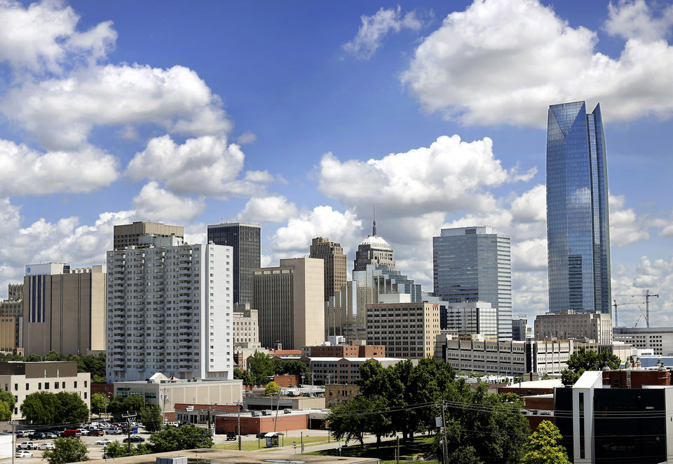 Photo -  The downtown Oklahoma City skyline is seen from NW 10 and Lee, looking southeast. [Jim Beckel/The Oklahoman]