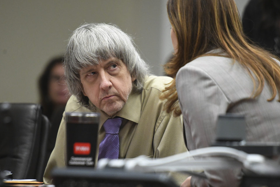 Photo -  David Turpin listens to his attorney, Allison Lowe, during a sentencing hearing Friday, April 19, 2019, in Riverside, Calif. Turpin and his wife, Louise, who pleaded guilty to years of torture and abuse of 12 of their 13 children have been sentenced to life in prison with possibility of parole after 25 years. (Will Lester/The Orange County Register via AP, Pool)
