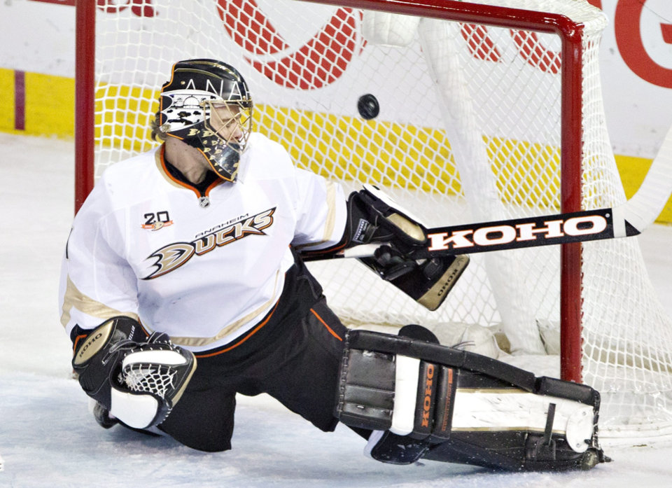 Photo - Anaheim Ducks goalie Jonas Hiller (1) is scored on by the Edmonton Oilers during second-period NHL hockey game action in Edmonton, Alberta, Friday, March 28, 2014. (AP Photo/The Canadian Press, Jason Franson)
