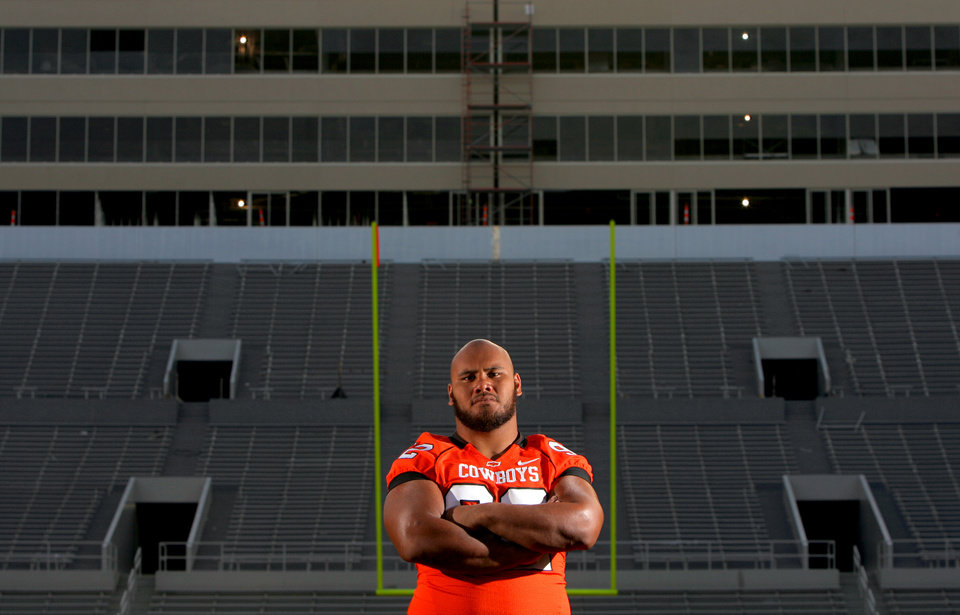 Photo - FOOTBALL SECTION PHOTO -- DO NOT USE!!! OSU COLLEGE FOOTBALL: Oklahoma State University defensive tackle Tonga Tea Jr., a junior college transfer, poses for a photo in front of the new west end zone at Boone Pickens Stadium in Stillwater, Okla., Wednesday, August 6, 2008. BY MATT STRASEN, THE OKLAHOMAN ORG XMIT: KOD